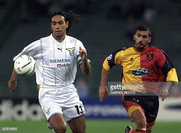 Lazio Rome's defender Alessandro Nesta and Galatasaray's forward Umit Karan fight for the ball during the UEFA's Champions' League match Lazio Rome...