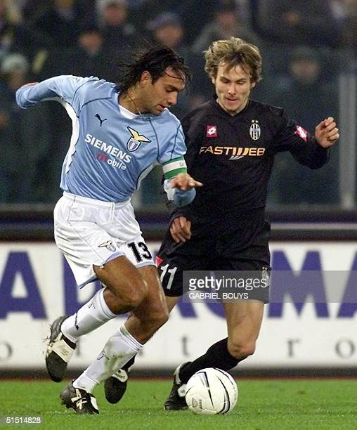 Lazio Rome's defender Alessandro Nesta vies Czech Juventus' midfielder Pavel Nedved during the Italian first league match Lazio/Juventus at the...