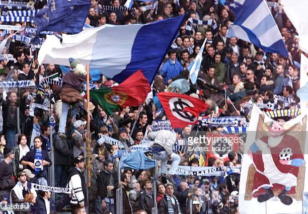 Lazio Rome's fans with neonazi's flags celebrate the entrance of their players 21 November 1999 during the derby AS RomaLazio Roma at the Olympic...