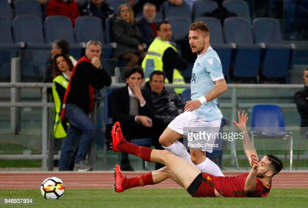 Lazio s Ciro Immobile left and Roma s Kostas Manolas fight for the ball during the Serie A soccer match between Lazio and Roma at the Olympic stadium