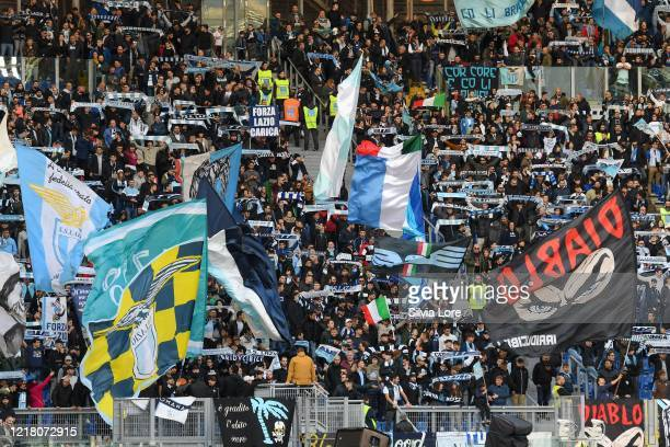 Lazio supporters wave a flag before the Serie A match between SS Lazio and Udinese Calcio at Stadio Olimpico on December 01 2019 in Rome Italy