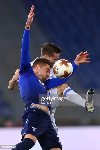 SS Lazio v FC Dynamo Kyiv UEFA Europa League Round of 16 1st leg Sergej MilinkovicSavic of Lazio and Tomasz Kedziora of Dynamo Kyiv at Olimpico...