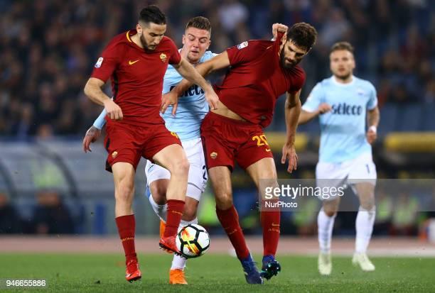 Lazio v Roma Serie A Sergej MilinkovicSavic of Lazio between Konstantin Manolas and Federico Fazio of Roma at Olimpico Stadium in Rome Italy on April...