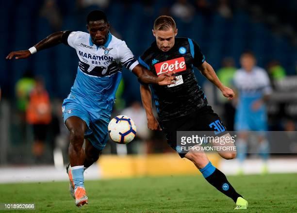 Lazio's Angolan defender Bastos and Napoli's Croatian midfielder Marko Rog go for the ball during the Italian Serie A football match Lazio vs Napoli...