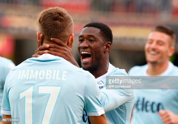 Lazio's Angolan defender Bastos celebrates with teammate Ciro Immobile after scoring during the Italian Serie a football match Benevento Calcio vs SS...