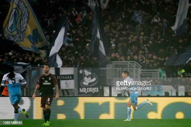 Lazio's Argentine forward Joaquin Correa celebrates after scoring an equalizer during the Italian Serie A football match Lazio Rome vs AC Milan on...
