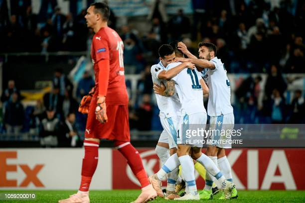 Lazio's Argentine forward Joaquin Correa celebrates with Lazio's Italian defender Danilo Cataldi and Lazio's Brazilian defender Luiz Felipe after he...