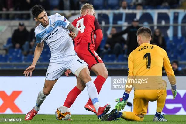 Lazio's Argentine forward Joaquin Correa challenges Sevilla's Danish defender Simon Kjaer and Sevilla's Czech goalkeeper Tomas Vaclik during the UEFA...