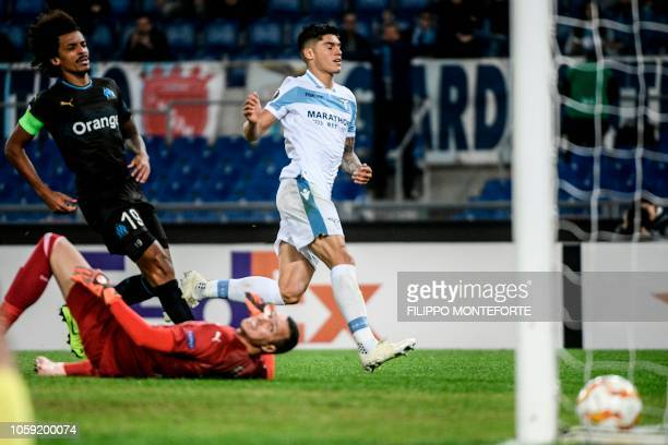 Lazio's Argentine forward Joaquin Correa scores his team's second goal past Marseille's French goalkeeper Yohan Pele during the UEFA Europa League...