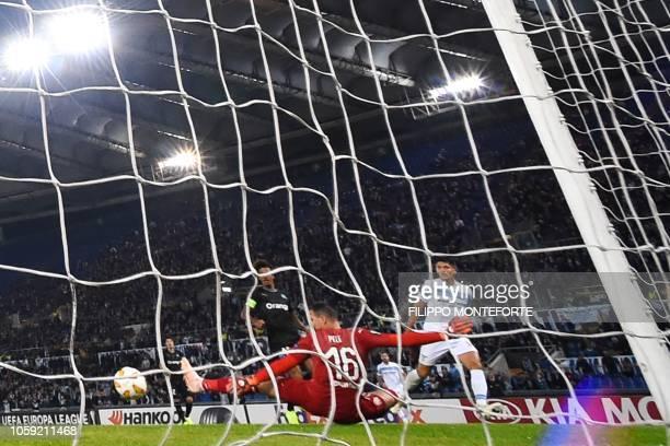 TOPSHOT Lazio's Argentine forward Joaquin Correa scores past Marseille's French goalkeeper Yohan Pele during the UEFA Europa League group H football...