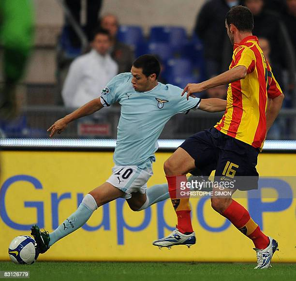 Lazio's Argentine forward Mauro Matias Zarate fights for the ball with Lecce's defender Andrea Esposito during their Italian Serie A football match...