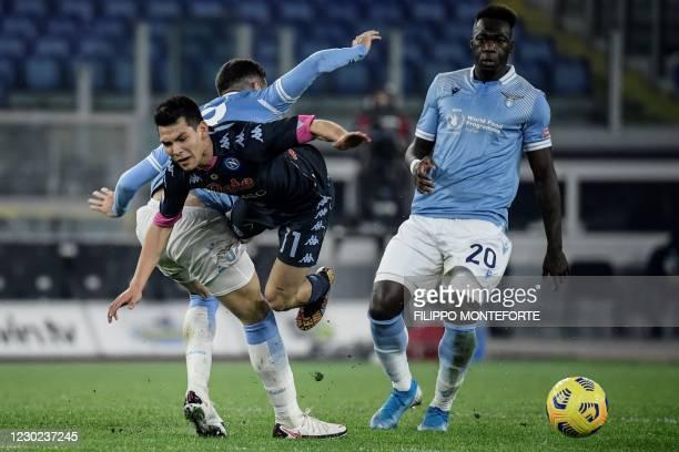 Lazio's Argentine midfielder Gonzalo Escalante obstructs Napoli's Mexican forward Hirving Lozano as Lazio's Ecuadorian forward Felipe Caicedo looks...