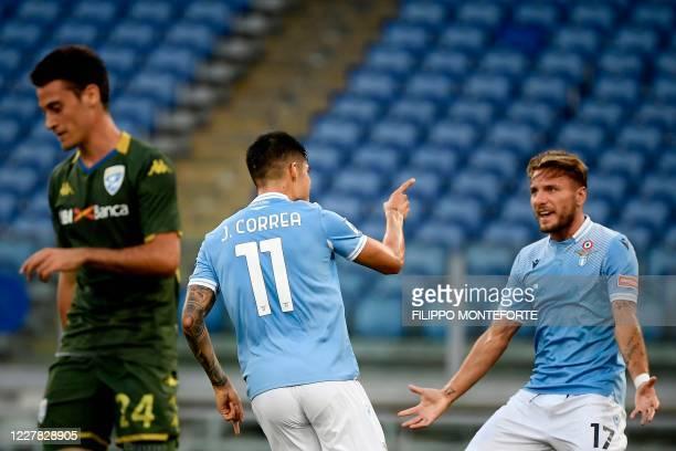 Lazio's Argentine midfielder Joaquin Correa celebrates with Lazio's Italian forward Ciro Immobile after scoring during the Serie A football match...