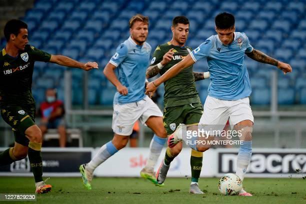 Lazio's Argentine midfielder Joaquin Correa shoots to score during the Serie A football match Lazio vs Brescia at the Olympic Stadium in Rome on July...