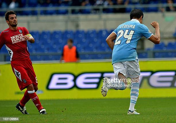 Lazio's Argentinian midfielder Cristian Ledesma celebrates after scoring a penalty against Siena on September 30 2012 during a Serie A football match...