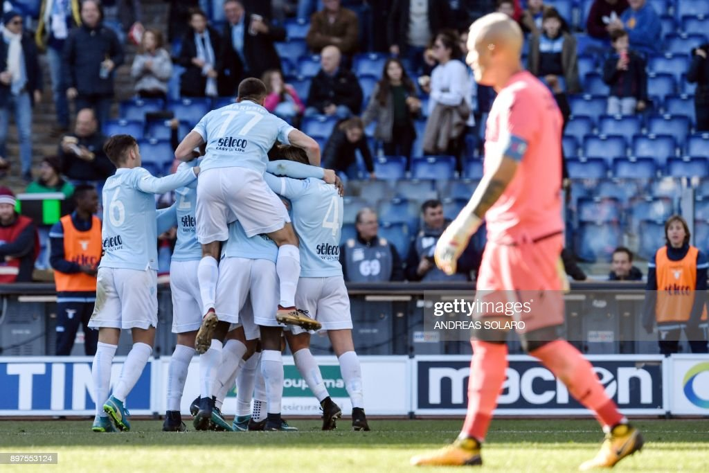 Lazio's Belgian defender Jordan Lukaku (unseen) celebrates with teammates after scoring a goal during the Italian Serie A football match between Lazio and Crotone at The 'Olympic' Comunal Stadium in Rome, on December 23, 2017. / AFP PHOTO / Andreas SOLARO