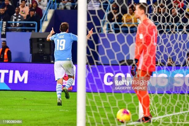 Lazio's Bosnian midfielder Senad Lulic celebrates after scoring during the Supercoppa Italiana final football match between Juventus and Lazio at the...