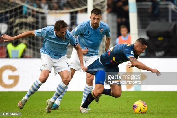 Lazio's Bosnian midfielder Senad Lulic holds off Lecce's Italian forward Gianluca Lapadula during the Italian Serie A football match Lazio Rome vs...