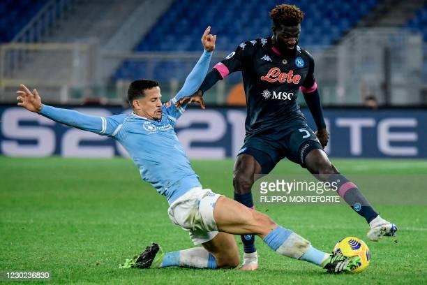 Lazio's Brazilian defender Luiz Felipe tackles Napoli's French midfielder Tiemoue Bakayoko during the Italian Serie A football match Lazio vs Napoli...