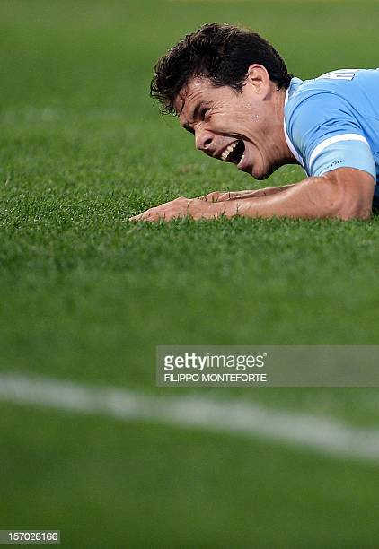 Lazio's Brazilian midfielder Anderson Hernanes reacts during the Serie A football match between Lazio and Udinese at Rome's Olympic Stadium on...