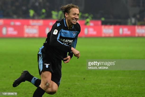 Lazio's Brazilian midfielder Lucas Leiva celebrates after scoring the winning penalty during the final shootout of the Italian Tim Cup round of eight...