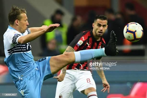 Lazio's Brazilian midfielder Lucas Leiva defends against AC Milan's Spanish forward Suso during the Italian Serie A football match AC Milan vs Lazio...