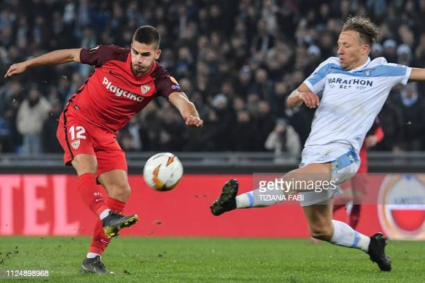 Lazio's Brazilian midfielder Lucas Leiva defends against Sevilla's Portuguese forward Andre Silva during the UEFA Europa League round of 16 first leg...