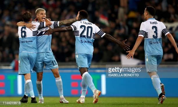 Lazio's Brazilian midfielder Lucas Leiva Lazio's Argentine forward Joaquin Correa Lazio's Ecuadorian forward Felipe Caicedo and Lazio's Brazilian...