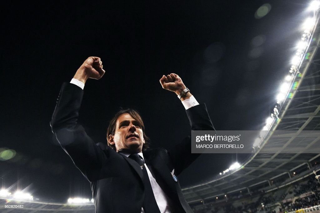 Lazio's coach Simone Inzaghi from Italy celebrates at the end of the Italian Serie A football match Torino Vs Lazio on April 29, 2018 at the 'Grande Torino Stadium' in Turin.