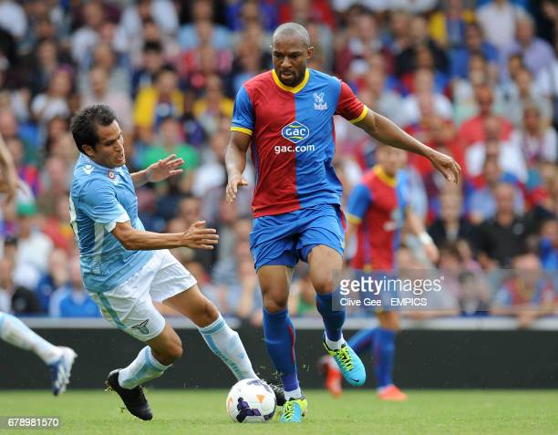 Lazio's Cristian Ledesma and Crystal Palace's Danny Gabbidon battle for the ball during the preseason friendly at Selhurst Park South London