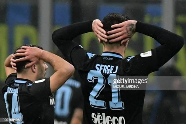 Lazio's Danish defender Riza Durmisi and Lazio's Serbian midfielder Sergej Milinkovic-Savic react after their teammissed a last minute goal during...