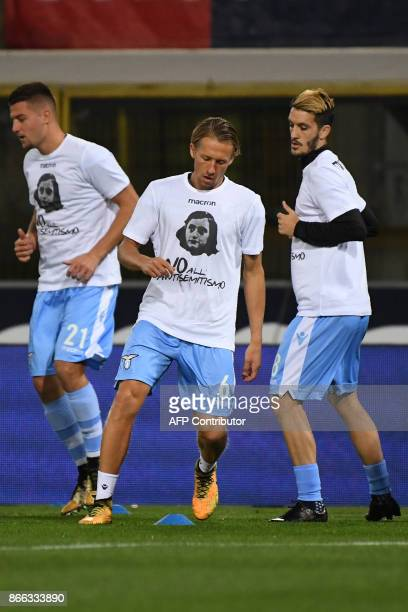 Lazio's defender from Brazil Lucas Leiva and teammates wear tshirts against antisemitism showing an image of holocaust victim Anne Frank during the...
