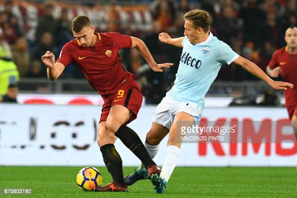 Lazio's defender from Brazil Lucas Leiva vies with Roma's Bosnian striker Edin Dzeko during the Italian Serie A football match AS Roma vs Lazio on...