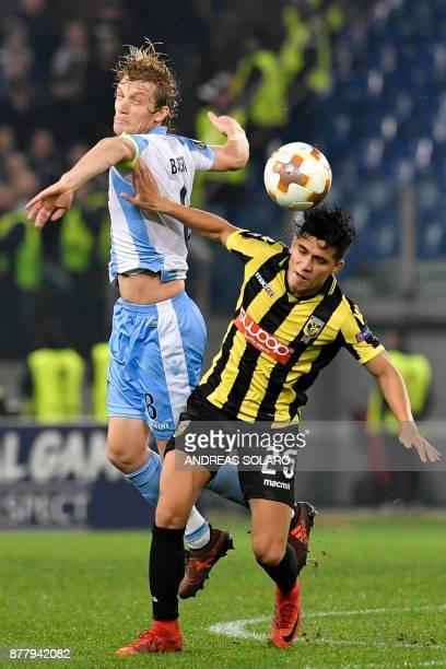 Lazio's defender from Serbia Dusan Basta jumps for the ball whit Vitesse Arnhem's midfielder from Netherlands Navarone Foor during the UEFA Europa...