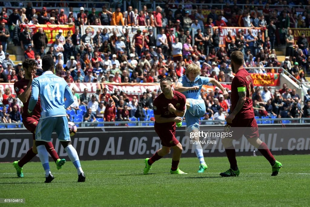Lazio's defender from Serbia Dusan Basta (2ndR) scores during the Italian Serie A football match Roma vs Lazio at the Olympic Stadium in Rome on April 30, 2017. /