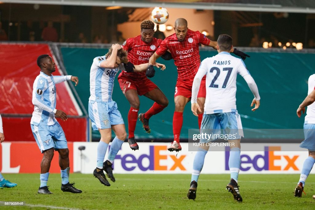 Lazio's Dusan Basta (2nd L) vies for the ball with Zulte's Aaron Leya Iseka (C) and Zulte's Marvin Baudry (2nd R) during the UEFA Europa League Group K football match between Zulte Waregem and SS Lazio on December 7, 2017, in Waregem. / AFP PHOTO / Belga / KURT DESPLENTER / Belgium OUT