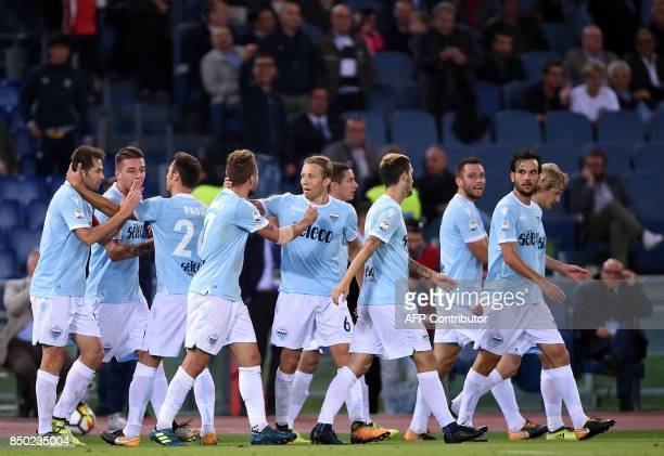 Lazio's Dutch defender Stefan de Vrij celebrates with teammates after scoring a goal during the Italian Serie A football match between Lazio and...