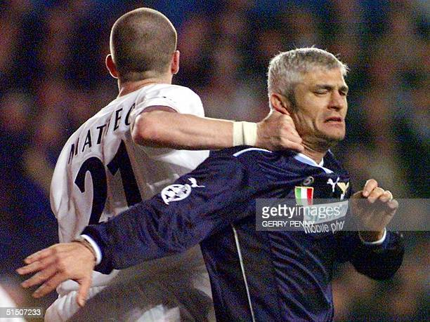 Lazio's Fabrizio Ravanelli tangles with Leeds United's Dominic Matteo 14 March 2001 during their UEFA group D Champions League match at Elland Road...