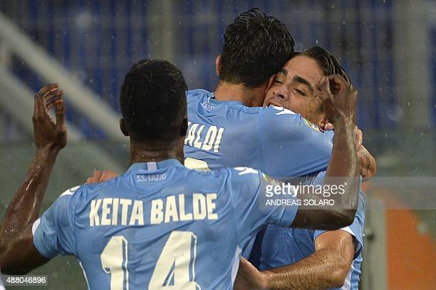 Lazio's forward Alessandro Matri celebrates with his team mates after scoring against Udinese during the Italian Serie A football match Lazio vs...