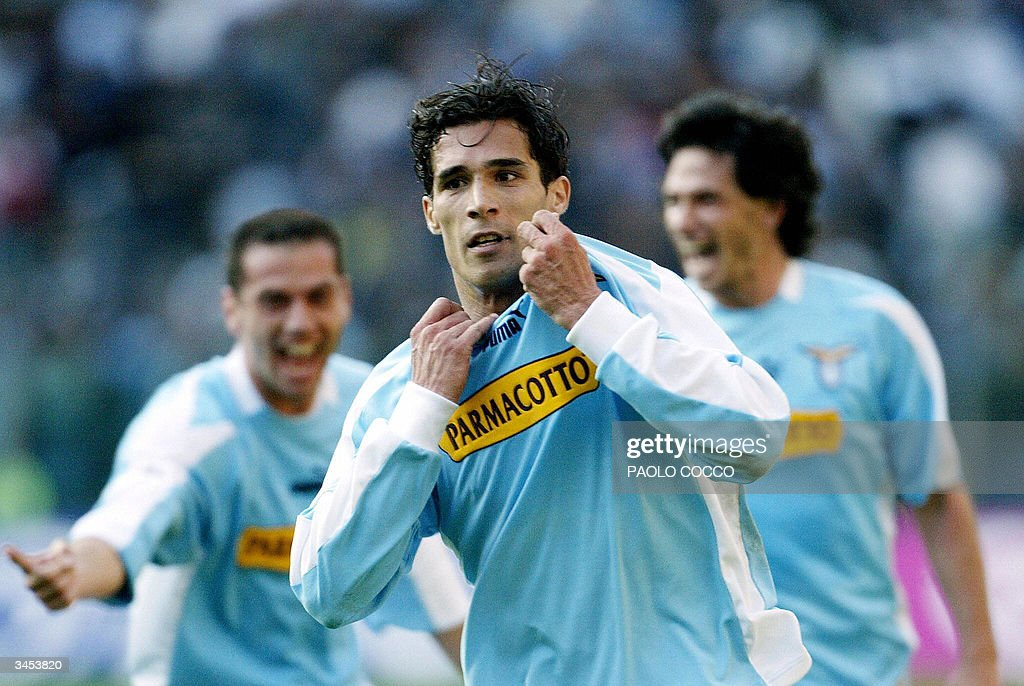 Lazio's forward Bernardo Corradi (C) celebrates with teammates after scoring against AS Roma during their Serie A soccer match at Rome's Olympic stadium 21 April 2004.