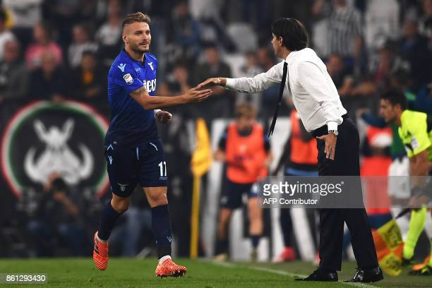 Lazio's forward Ciro Immobile celebrates with Lazio's coach Simone Inzaghi after scoring during the Italian Serie A football match Juventus Vs Lazio...