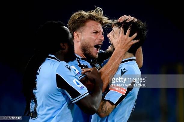 Lazio's forward Ciro Immobile celebrates with teammates after scoring during the Serie A football match Lazio vs Cagliari at the Olympic Stadium in...