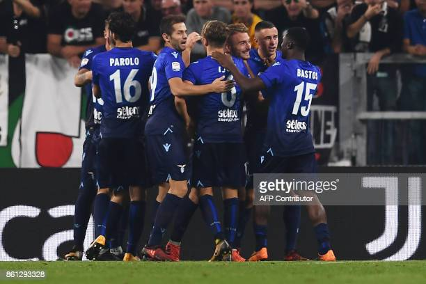 Lazio's forward Ciro Immobile celebrates with teammates after scoring during the Italian Serie A football match Juventus Vs Lazio on October 14 2017...