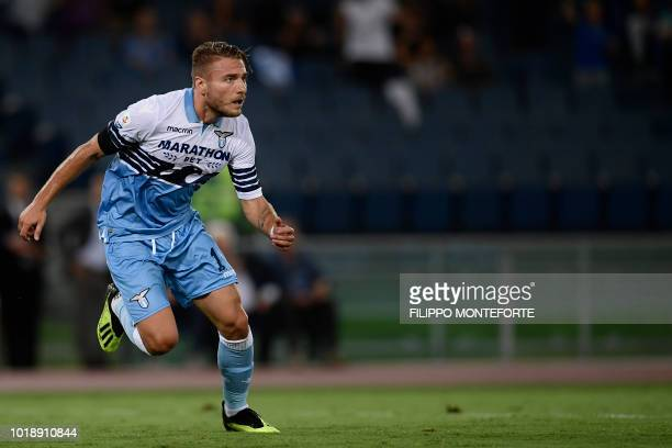 Lazio's forward Ciro Immobile reacts after opening the scoring during the Italian Serie A football match Lazio vs Napoli at the Olympic stadium in...