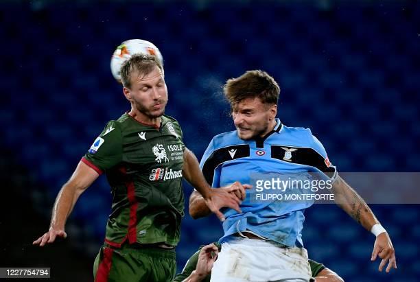Lazio's forward Ciro Immobile vies with Cagliari's Ragnar Klavan defender from Estonia during the Serie A football match Lazio vs Cagliari at the...