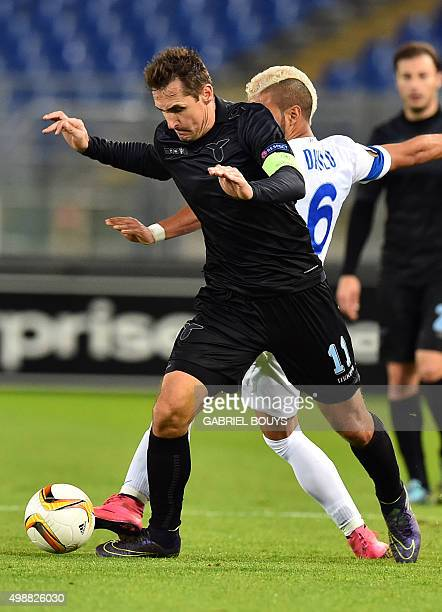 Lazio's forward from Germany Miroslav Klose vies with Dnipropetrovsk's midfielder from Brazil Danilo during the UEFA Europa League football match...
