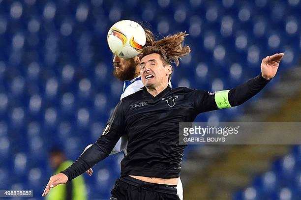 Lazio's forward from Germany Miroslav Klose vies with Dnipropetrovsk's defender from Ukraine Dmytro Chygrynskiy during the UEFA Europa League...