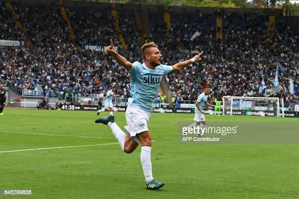 Lazio's forward from Italy Ciro Immobile celebrates after scoring his second goal during the Italian Serie A football match Lazio vs AC Milan on...