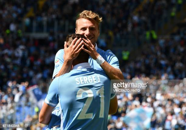 Lazio's forward from Italy Ciro Immobile celebrates with teammate Lazio's midfielder from Serbia Sergej MilinkovicSavic after scoring during the...