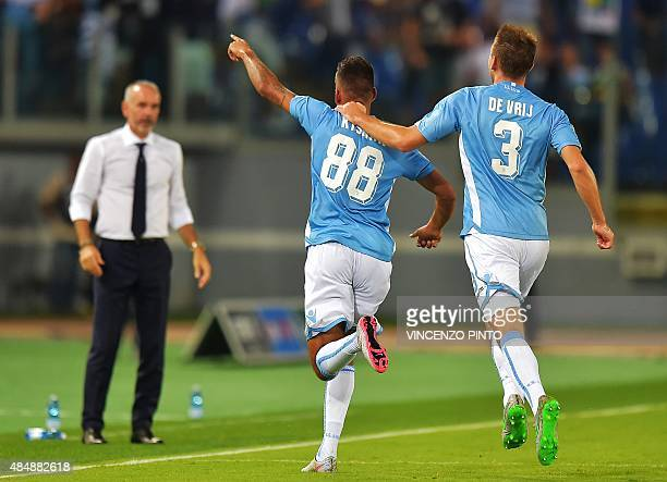 Lazio's forward from Netherlands Ricardo Kishna celebrates with Lazio's defender from Netherlands Stefan de Vrij in front of Lazio's coach from Italy...